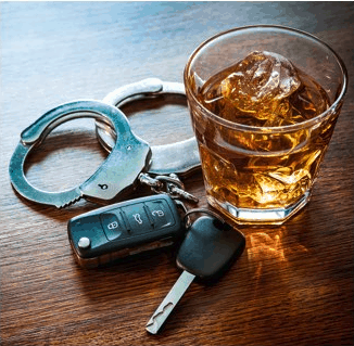 A pair of handcuffs next to an alcoholic beverage and a pair of car keys