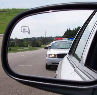 Police in rear view mirror